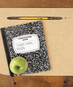Notebook, apple, and pencil