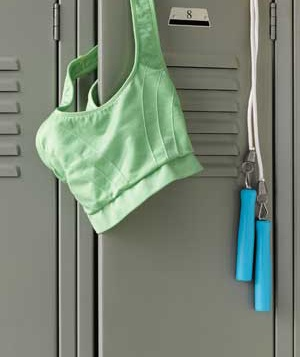 Green sports bra and jump rope hanging on locker