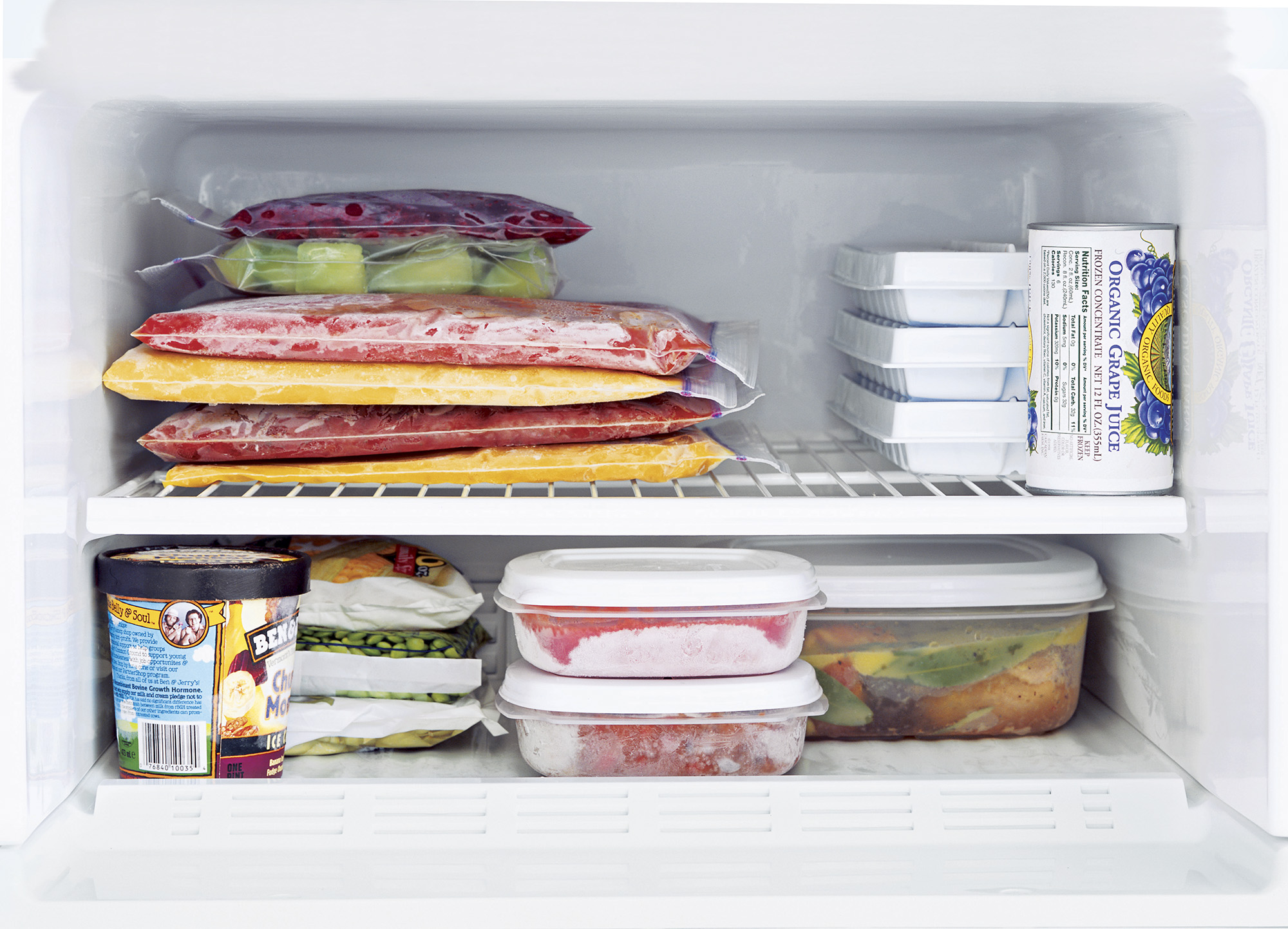 Freezer interior with frozen dinners, ziploc items, ice tray