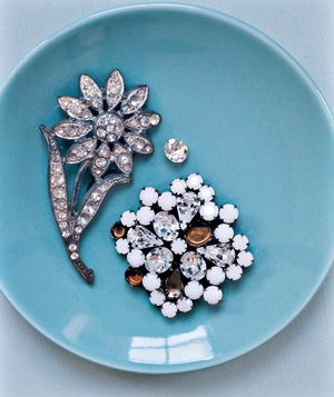 Brooches in a dish