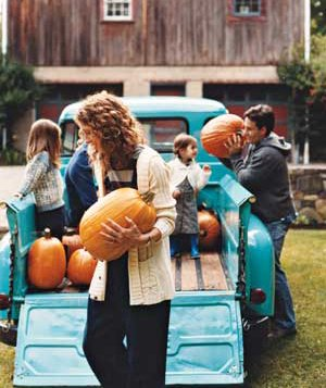 People carrying pumpkins