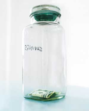Dollar bills in a jar