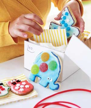 Child putting cookies in a box