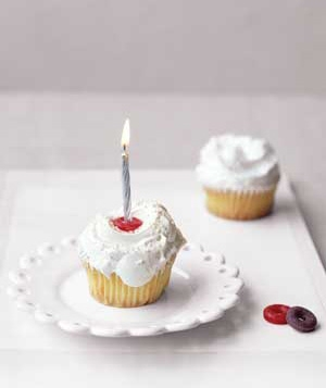 Cupcake with a candle held by a LifeSaver