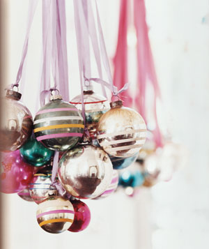 30 simple festive holiday decor ideas real simple ornament chandelier aloadofball Image collections