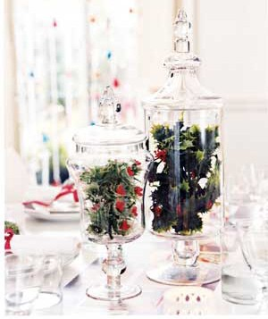 Artificial holly in a glass jar
