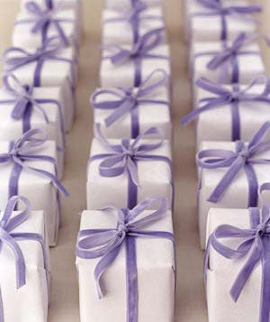 Small gifts wrapped with purple ribbon