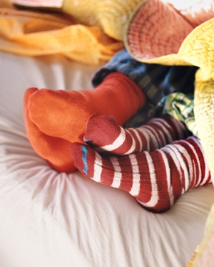 Kids wearing socks in bed