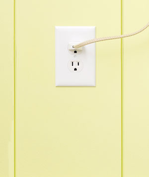 Outlet on a yellow wall