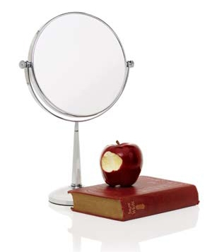 Freestanding mirror with an apple
