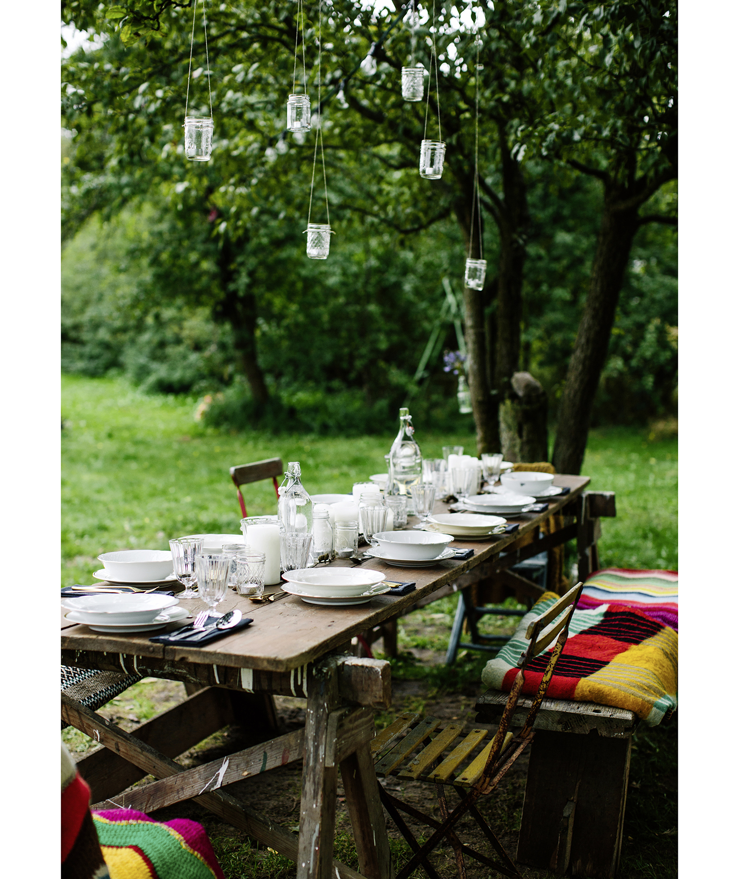 Garden party with wood table and small jar lights
