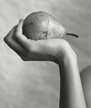 Woman holding a pear
