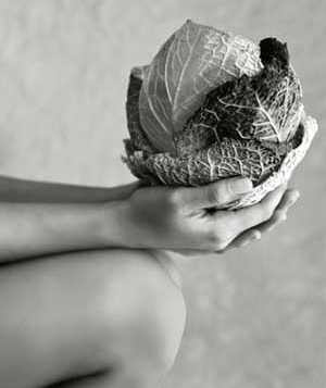 Woman holding a cabbage