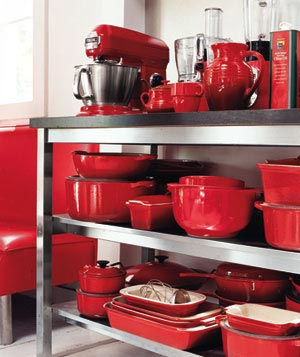 Bright Red Cookware On Shelves