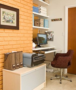 Convert an awkward little nook into a home office by installing sturdy shelves.
