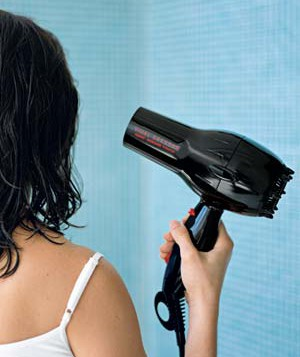 Woman blow-drying her hair