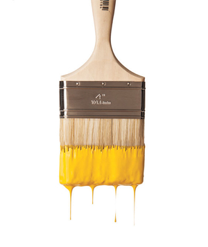 Yellow paint dripping from a paintbrush