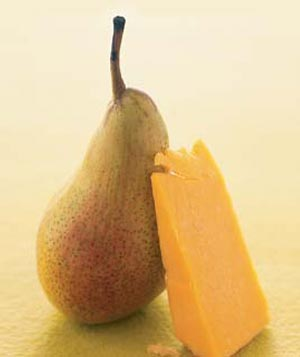 A pear and a piece of cheese
