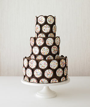 Tiered cake decorated with cookies