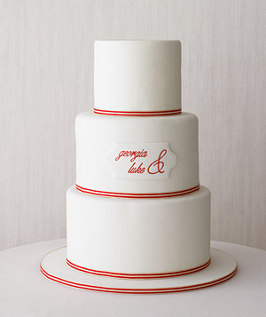 Tiered wedding cake with monogram