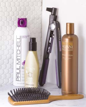 Styling products, flat iron, and hairbrush