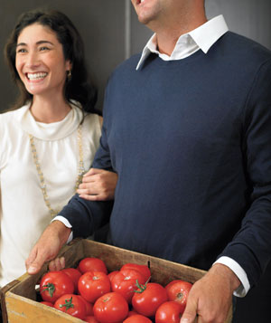 Man and woman with a crate of tomatoes