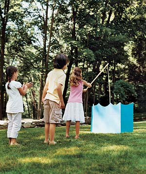 Send young guests at a backyard birthday party fishing for prizes.