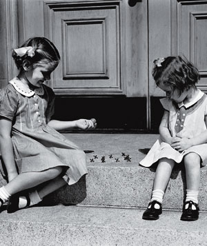 Children playing jacks