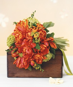 Bouquet of parrot tulips, freesia, and viburnum