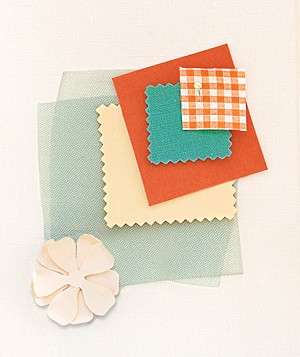 Ivory, aqua, and orange fabric swatches