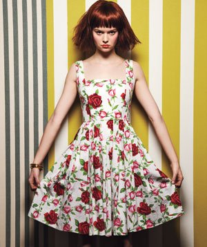 Model wearing floral Betsy Johnson stretch-cotton dress