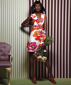 Model wearing Kate Spade silk floral dress