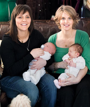 Two women, two babies family portrait