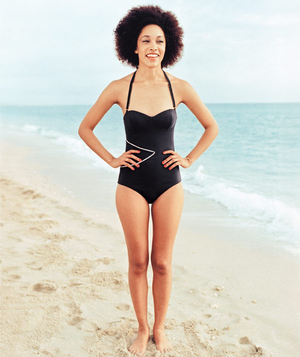Model wearing black and white halter one-piece