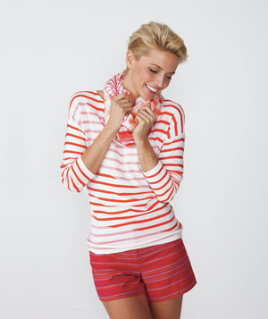 Model wearing red striped top, scarf, and shorts