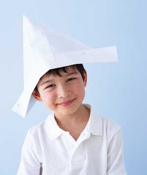 Boy wearing a paper hat