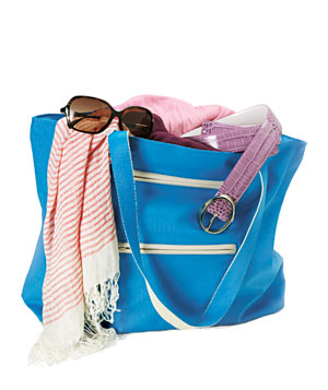 Blue bag with sunglasses, striped scarf and belt