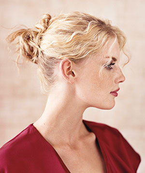 Pull curly or wavy hair into an elastic, then divide the ponytail into three sections. Twist each, and pin to scalp near elastic.