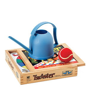 Wooden board game of Twister, blue watering can and a red ball