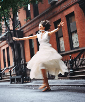 Woman running in white dress