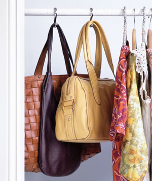 Handbags stored on shower-curtain hooks