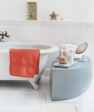 Make a long soak even more luxurious with bath salts, lush towels, and aromatic candles within easy reach.