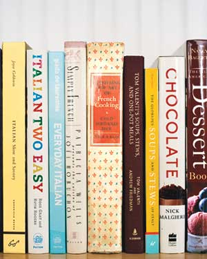 Cookbooks lined up on a shelf