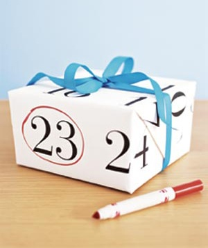 GIft wrapped in calendar sheet with date circled