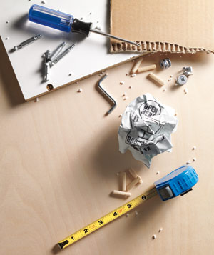 Screw driver, nuts, bolts and parts to assemble furniture