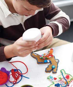 Child decorating a cookie