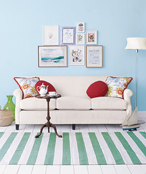 sofa with frames on the wall