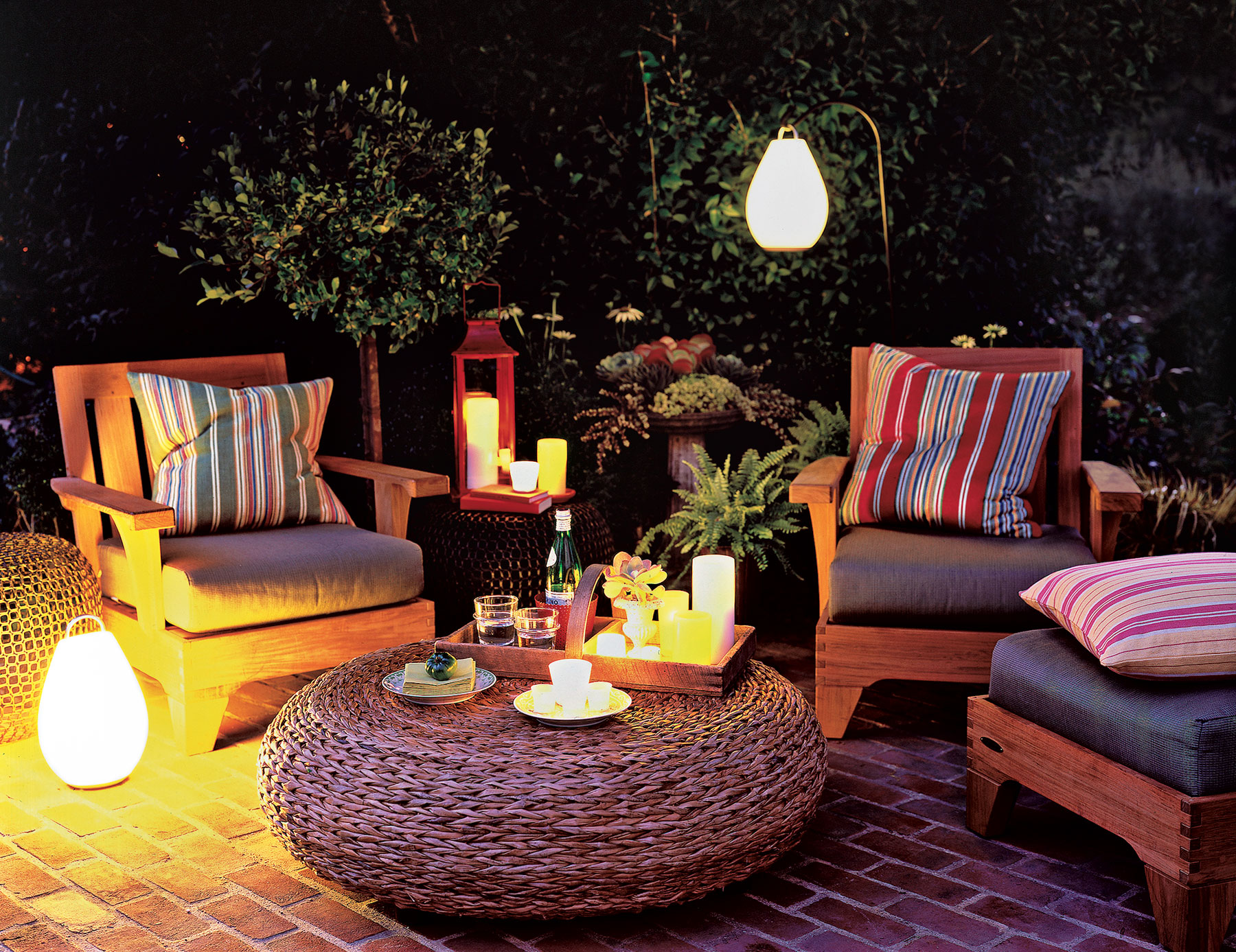 4 creative outdoor lighting ideas real simple backyard lit with battery powered lights aloadofball Images