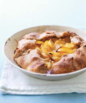 A hearty, easy-to-make tart brims with fresh peaches spiced with ginger and nutmeg.