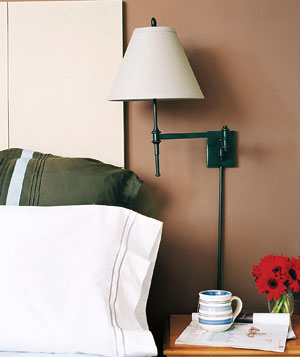 Wall-mounted lamp next to bed